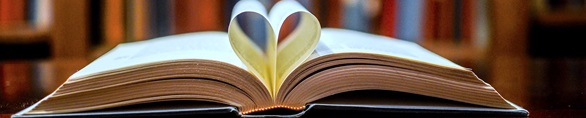 open book with center pages creating a heart
