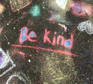 """""""Be kind"""" written in sidewalk chalk"""