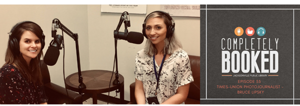Picture of Amanda and Gabby with headphones on and in front of microphones in room where they record library podcasts. Text: Completely Booked