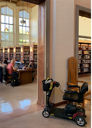 photo of scooter plugged in to charge at the Central Library