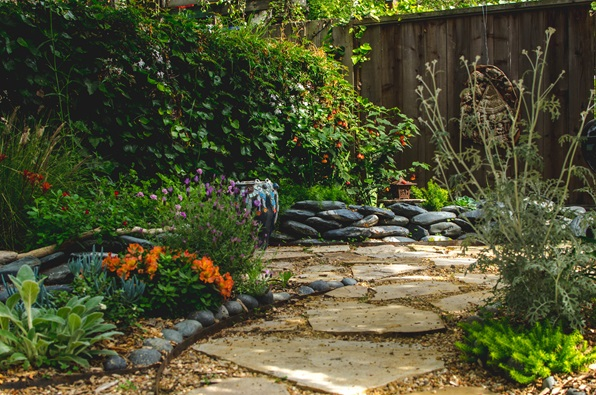 picture of a garden with stone pathways