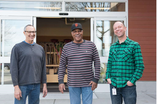 photo of three staff members standing in front of the Berkeley Public Tool Lending Library