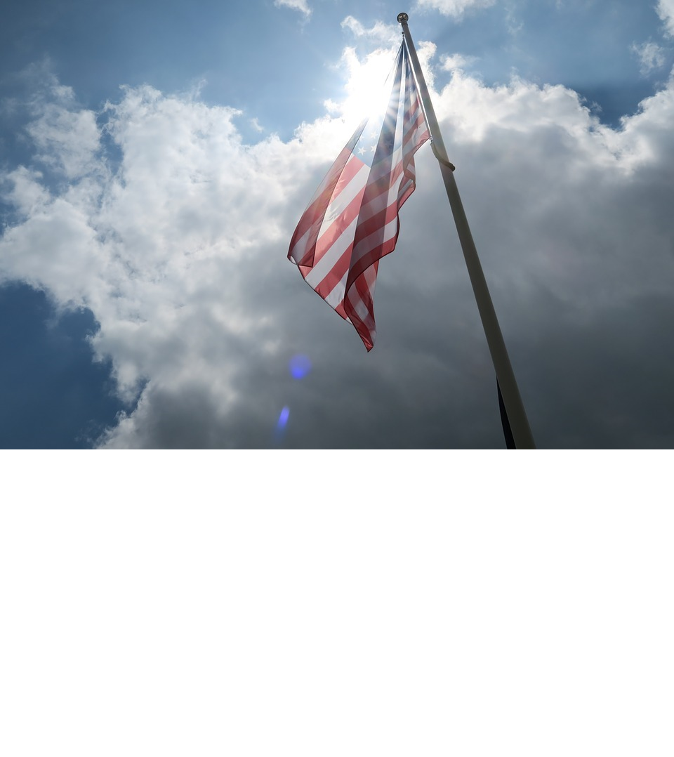 US flag with sun and sky background