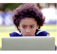 A student views their laptop screen with a slightly worried expression.