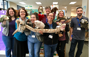 photo of library staff holding various puppets