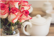 red and white roses with white teapot