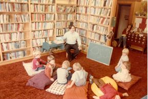 librarian reading story to group of children
