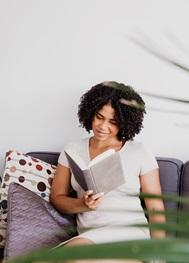 Young Woman Enjoying Reading a Book