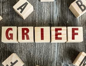 blocks that spell out GRIEF