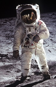 Photo of astronaut in space suit standing on the Moon