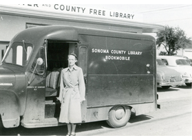 Frances G. Murphy in front of bookmobile