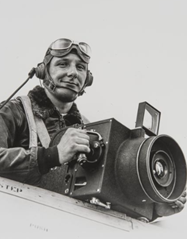 Sonoma County photographer Don Meacham on board of his plane holding a camera.